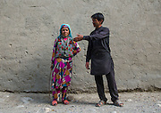 AFGHANISTAN WITHOUT TALIBANS<br /> <br /> There is a region in Afghanistan where the Talibans have never really been able to impose their rule. Wedged between Tajikistan and Pakistan, the Afghan Pamir is an area of precarious peace.<br /> Promoted by the Afghan government to try and attract tourists in search of adventure, it is also the gateway to the Wakhan Corridor that Marco Polo used in the 13th century and it is where the legendary nomads have lived isolated from the rest of the world at an altitude of 4,500 meters, with the only company of their yaks.<br /> <br /> For safety reasons, the border can only be crossed from Tajikistan. The Panj river separates the two states. It is 2pm and loud honking is necessary to draw the attention of the Afghan border guards busy playing volleyball.<br /> In the entrance of the border post, there is a portrait of Salah Abdeslam, the terrorist involved in the Paris attacks on 13 November 2015. The border guard mimes cuffed hands to convey to me that he was captured. Next to him, a poster displays all the presidents of Afghanistan. I recognize the current one, Ashraf Ghani, as well as his predecessor, Hamid Karzai, and on a blurry black and white picture reminiscent of a &laquo;&nbsp;Wanted&nbsp;dead or alive&raquo; poster, Mullah Omar!<br /> <br /> My passport is scanned and then mailed to Kabul to be checked against the database. &ldquo;Security,&quot; the border guard tells me. But the Internet connection is down. &ldquo;We&rsquo;ll check on your way back,&rdquo; he says, annoyed, before handing me my visa number 339.<br /> <br /> A few kilometers and potholes later, I arrive in Ishkashim, the largest village in the region, which boils down to two dusty roads lined with stalls. A Toyota pickup truck full of armed soldiers patrols at high speed. I see my first pakols, the famous hat immortalized by General Massoud, and surprise, women walking while all wearing blue burqas.<br /> The population of Pamir is predominantly Ismai