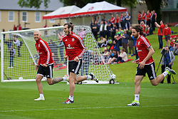 CARDIFF, WALES - Wednesday, June 1, 2016: Wales' Aaron Ramsey, Gareth Bale and Joe Allen during a training session at the Vale Resort Hotel ahead of the International Friendly match against Sweden. (Pic by David Rawcliffe/Propaganda)