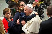 A Baby girl gives Pope Francis a Hug durig his weekly general audience at the Paul VI hall on January 10, 2018 at the Vatican.