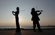 The Golfing Fiddle .Model Lynda Duffy  and Musician Frankie Gavin in a photocall for a Dubai Irish Trad Festival on  Sathill Promenade.Photo:Andrew Downes..