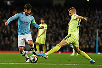 Manchester City's David Silva is tackled by Mislav Orsic of Dinamo Zagreb<br /> <br /> Football - 2019 / 2020 UEFA Champions League - Champs Lge Grp C: Man City-D Zagreb<br /> <br /> , at Etihad Stadium<br /> <br /> Colorsport / Terry Donnelly