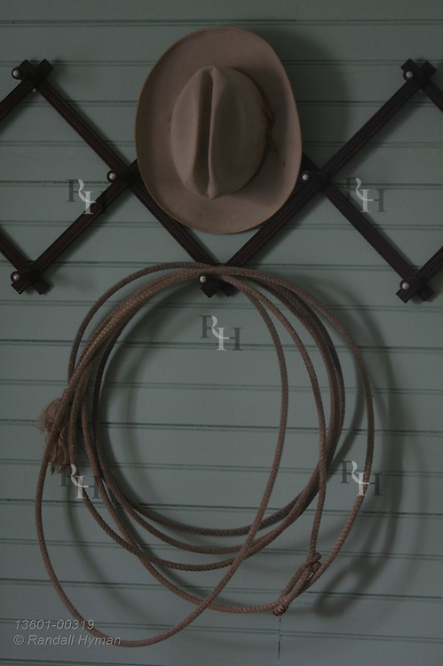 Cowboy hat and lasso, Will Rogers trademarks, hang on wall at Dog Iron Ranch, birthplace of Will Rogers; Oologah, Oklahoma.