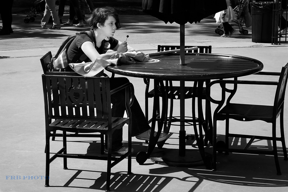 Young woman sitting at a table during an LGBT Festival in Worcester, MA