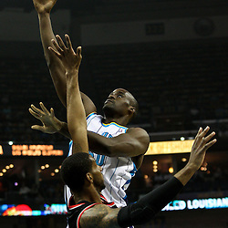 March 30, 2011; New Orleans, LA, USA; New Orleans Hornets center Emeka Okafor (50) shoots over Portland Trail Blazers power forward LaMarcus Aldridge (12) during the first half at the New Orleans Arena.    Mandatory Credit: Derick E. Hingle