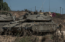 Israeli tanks are deployed in south Israel bordering the Gaza Strip on July 8, 2014. Israel's security cabinet decided on Tuesday to draft 40,000 reserve soldiers for a major military operation Israel launched on the Hamas-ruled Gaza Strip earlier in the day. EXPA Pictures © 2014, PhotoCredit: EXPA/ Photoshot/ Li Rui<br /> <br /> *****ATTENTION - for AUT, SLO, CRO, SRB, BIH, MAZ only*****