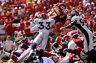 Running back Larry Johnson #27 of the Kansas City Chiefs dives to the goal line past safety Marquand Manuel #33 of the Denver Broncos in the second quarter at Arrowhead Stadium in Kansas City, Missouri on September 28, 2008.....