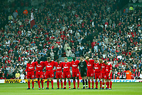 Liverpool's players and fans stand to observe a moments slience in memory of the 96 victims of the Hillsborough disaster in 1989 before the Premiership match against Fulham at Anfield, Liverpool, Saturday, April 12th, 2003.<br />