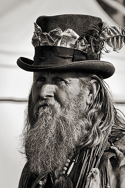 Mountain Man wearing a top hat lined with $2 bills at Fort Bridger's annual Mountain Man Rendezvous in Southern Wyoming.