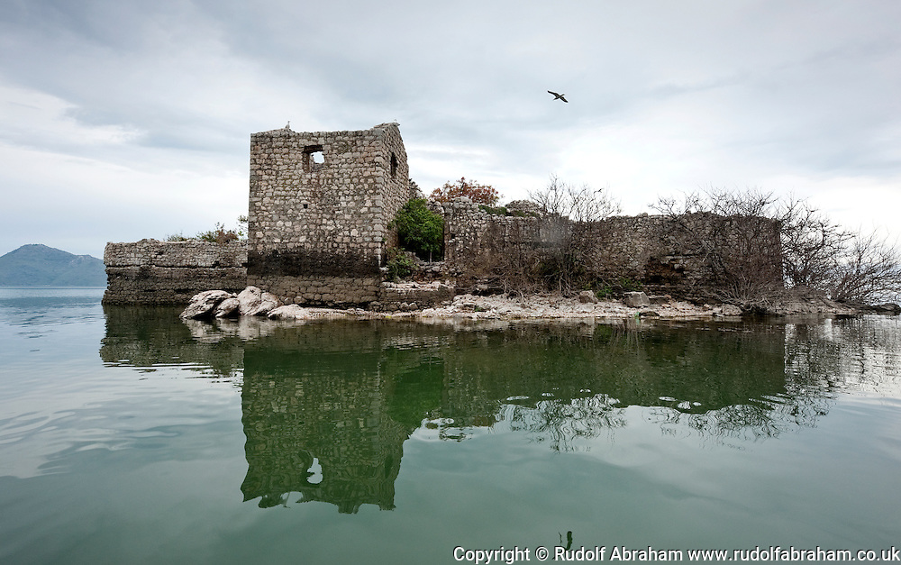 Ruined fortress on Grmozur island, later used as a prison. Lake Skadar (Skadarsko jezero) national park, Montenegro