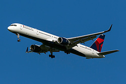 Delta Airlines Boeing 757-351 (registration N583NW) approaches San Francisco International Airport (SFO) over San Mateo, California, United States of America