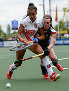 Surbiton's Emily Atkinson challenges with Amsterdam's Yasmin Geerlings during the bronze medal match at the EHCC 2017 at Den Bosch HC, The Netherlands, 5th June 2017