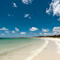 Tropical beach with blue sky and white sand