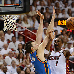 Jun 17, 2012; Miam, FL, USA; Miami Heat power forward Chris Bosh (1) drives to the basket against Oklahoma City Thunder power forward Nick Collison (4) during the second half in game three in the 2012 NBA Finals at the American Airlines Arena. Miami won 91-85. Mandatory Credit: Derick E. Hingle-US PRESSWIRE