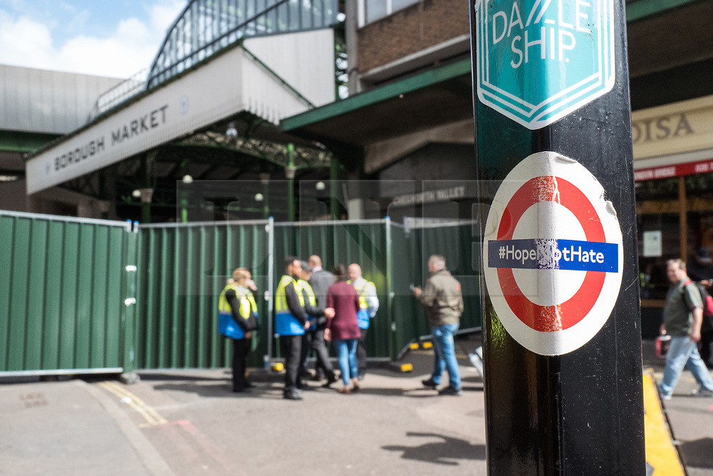 © Licensed to London News Pictures. 12/06/2017. London, UK. A 'Hope Not Hate' sticker attached to a lamppost outside Borough Market as traders re-enter the market to begin clearing up ahead of reopening. The market was the scene of a terrorist attack on Saturday 3 June 2017 in which eight people were killed. Photo credit: Rob Pinney/LNP