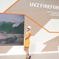 The Russian company Uralvagonzavod (UVZ) is the largest main battle tank manufacturer in the world. At the arms fair IDEX 2013 in Abu Dhabi UVZ is presenting its product with the help of an attractive hostess.