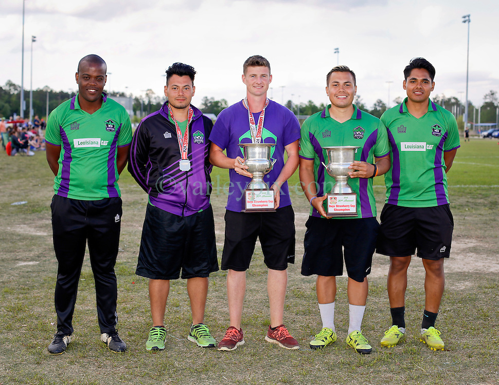 10 April 2016. Hammond, Louisiana.<br /> South Tangi Youth Soccer Association (STYSA), Chappapeela Sports Complex, 30th Annual Strawberry Cup,  <br /> New Orleans Jesters Youth Academy coaches celebrate 2 Championship Cup victories.  <br /> Photo©; Charlie Varley/varleypix.com