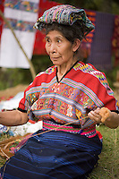 Mayan woman working with thread for weaving, Comalapa, Guatemala.