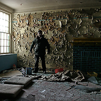 A man standing in a derelict room