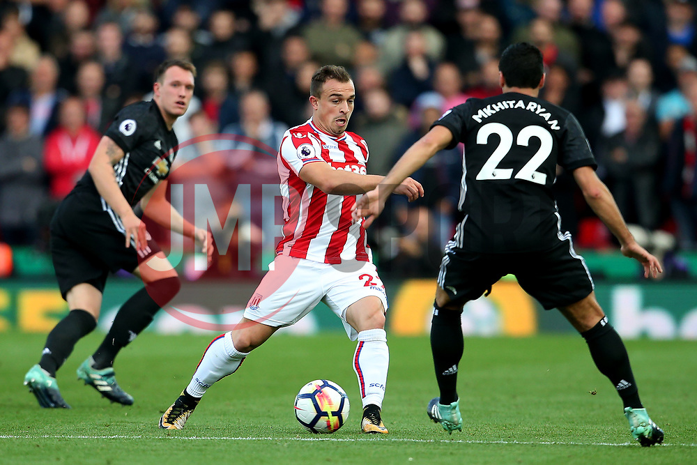 Xherdan Shaqiri of Stoke City takes on Henrikh Mkhitaryan of Manchester United - Mandatory by-line: Matt McNulty/JMP - 09/09/2017 - FOOTBALL - Bet365 Stadium - Stoke-on-Trent, England - Stoke City v Manchester United - Premier League