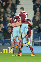 West Ham's James Tomkins celebrates with his team mates after scoring. - Photo mandatory by-line: Dougie Allward/JMP - Mobile: 07966 386802 - 02/12/2014 - SPORT - Football - West Bromwich - The Hawthorns - West Bromwich Albion v West Ham United - Barclays Premier League