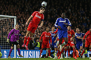 Steven Gerrard of Liverpool beats Kurt Zouma of Chelsea to the ball during the Capital One Cup Semi Final 2nd Leg match between Chelsea and Liverpool at Stamford Bridge, London, England on 27 January 2015. Photo by David Horn.