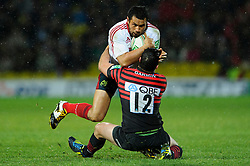 Munster Outside Centre (#13) Casey Laulala is tackled by Saracens Inside Centre (#12) Brad Barritt during the second half of the match - Photo mandatory by-line: Rogan Thomson/JMP - Tel: Mobile: 07966 386802 16/12/2012 - SPORT - RUGBY - Vicarage Road - Watford. Saracens v Munster Rugby - Heineken Cup Round 4.