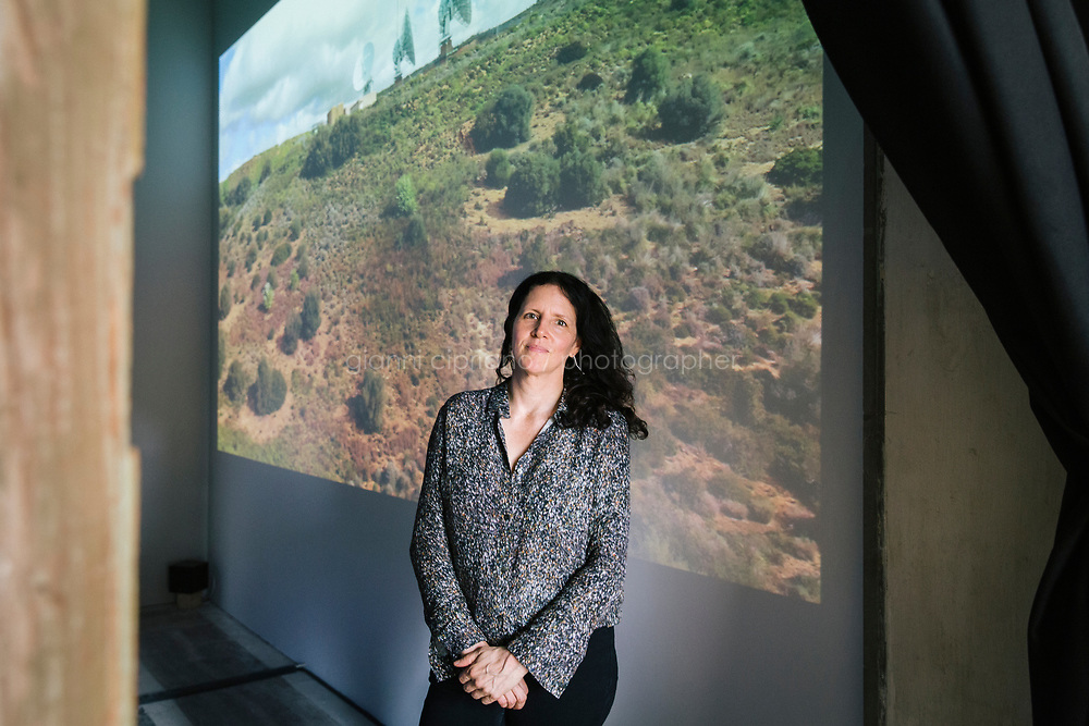 PALERMO, ITALY - 15 JUNE 2018: Documentary director Laura Poitras poses for a portrait in front of her video installation &quot;Signal Flow&quot; (2018) at Palazzo Forcella De Seta during Manifesta 12, the European nomadic art biennal, in Palermo, Italy, on June 15th 2018.<br /> <br /> Manifesta is the European Nomadic Biennial, held in a different host city every two years. It is a major international art event, attracting visitors from all over the world. Manifesta was founded in Amsterdam in the early 1990s as a European biennial of contemporary art striving to enhance artistic and cultural exchanges after the end of Cold War. In the next decade, Manifesta will focus on evolving from an art exhibition into an interdisciplinary platform for social change, introducing holistic urban research and legacy-oriented programming as the core of its model.<br /> Manifesta is still run by its original founder, Dutch historian Hedwig Fijen, and managed by a permanent team of international specialists.<br /> <br /> The City of Palermo was important for Manifesta&rsquo;s selection board for its representation of two important themes that identify contemporary Europe: migration and climate change and how these issues impact our cities.