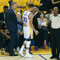 12 June 2017: Golden State Warriors head coach Steve Kerr is seen with Golden State Warriors guard Stephen Curry (30) during the Golden State Warriors 129-120 victory over the Cleveland Cavaliers, in game 5 of the 2017 NBA Finals, at the Oracle Arena, Oakland, California, USA.