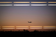 A small prop plane takes off at sunrise from the Indianapolis international airport Wednesday, March 8, 2017 in Indianapolis.