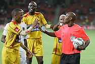 Referee Harry Lekitlane tries to calm things down after Tyren Arendse and Musa Otieno Ongao argue with him for disallowing Santos' goal during the PSL match between Santos and Kaizer Chiefs held at The Nelson Mandela Bay Stadium in Port Elizabeth, Eastern Cape South Africa on 20 November 2009 ..Photo by RG/www.sportzpics.net.+27 21 (0) 21 785 6814