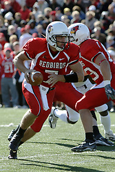 14 October 2006: Luke Drone scrambling.&#xD;The 6th largest crowd at Hancock Stadium came to watch a game that put 8th ranked Southern Illinois Salukis against 5th ranked Illinois State University Redbirds.  The Redbirds stole the show for a Homecoming win by a score of 37 - 10. Competition commenced at Hancock Stadium on the campus of Illinois State University in Normal Illinois.<br />