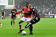 Pierre-Michel Lasogga (9) of Leeds United is challenged by Jonathan Leko (45) of Bristol City during the EFL Sky Bet Championship match between Bristol City and Leeds United at Ashton Gate, Bristol, England on 21 October 2017. Photo by Graham Hunt.