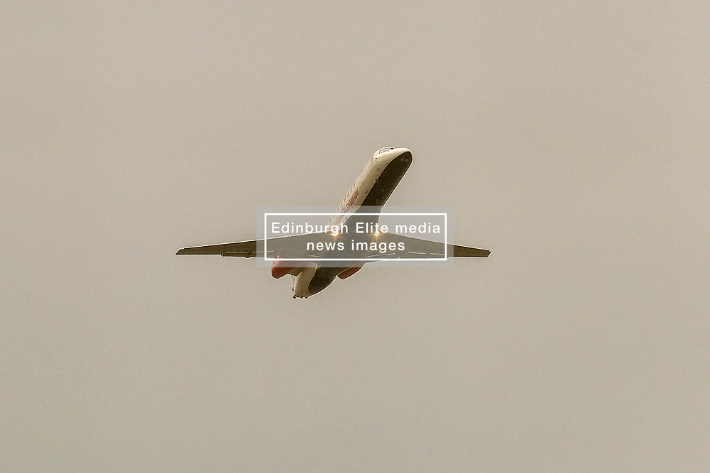 High Winds at Edinburgh Airport, Tuesday 7th January 2020<br /> <br /> Planes struggled on landing and take-off as high winds hit Edinburgh Airport today<br /> <br /> Pictured: A Loganair flight takes off into the dark overcast sky<br /> <br /> Alex Todd | Edinburgh Elite media