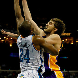 April 9, 2012; New Orleans, LA, USA; Los Angeles Lakers power forward Pau Gasol (16) shoots over New Orleans Hornets power forward Carl Landry (24) during the second half of a game at the New Orleans Arena. The Lakers defeated the Hornets 93-91. Mandatory Credit: Derick E. Hingle-US PRESSWIRE