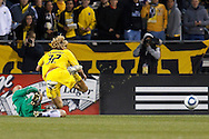8 MAY 2010:  New England Revolutions' Preston Burpo (24) slides into Steven Lenhart of the Columbus Crew (32) during MLS soccer game between New England Revolution vs Columbus Crew at Crew Stadium in Columbus, Ohio on May 8, 2010.