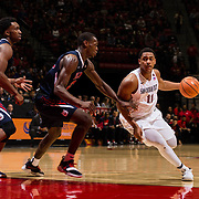 17 January 2018: San Diego State Aztecs forward Matt Mitchell (11) drives the ball into the key against a Fresno defender in the second half. San Diego State dropped a tough game to Fresno State 77-73 at Viejas Arena. <br /> More game action at www.sdsuaztecphotos.com