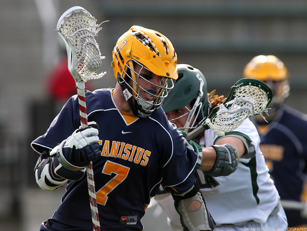 May 12, 2012; Baltimore, MD, USA; Canisius College Golden Griffins Brendan O'Hagan (7) against Loyola Maryland Greyhounds Josh Hawkins (5) at Ridley Athletic Complex in Baltimore, MD. Mandatory Credit: Brian Schneider-www.ebrianschneider.com
