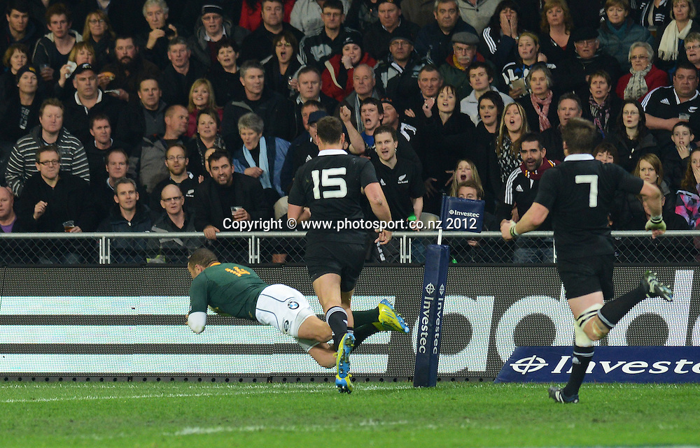 Bryan Habana dives over the try line. The Rugby Championship test match, New Zealand All Blacks versus South Africa Springboks. Dunedin. New Zealand. Saturday 15 September 2012. Mandatory Photo Credit: © Andrew Cornaga/Photosport.co.nz