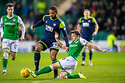 Lewis Stevenson (#16) of Hibernian FC tackles Marios Ogboe (#99) of Hamilton Academical FC during the Ladbrokes Scottish Premiership match between Hibernian FC and Hamilton Academical FC at Easter Road Stadium, Edinburgh, Scotland on 22 January 2020.