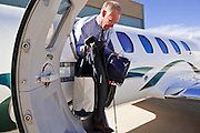 31 OCTOBER 2010 - SCOTTSDALE, AZ: Terry Goddard climbs out of the plane upon his return to Scottsdale Airpark Sunday. Goddard, and the other Democrats on the statewide ticket, campaigned in Window Rock and Kingman on Halloween. Goddard ended the day with a press conference in front of the Executive Office Tower at the State Capitol in Phoenix. Goddard lost the election to sitting Governor Jan Brewer, a conservative Republican.     PHOTO BY JACK KURTZ