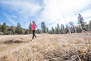 Caitlin Looby trail running at Palomar Mountain State Park, California.