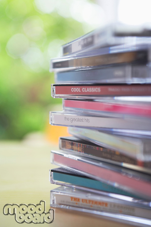 Pile of CD jewel cases on table close-up