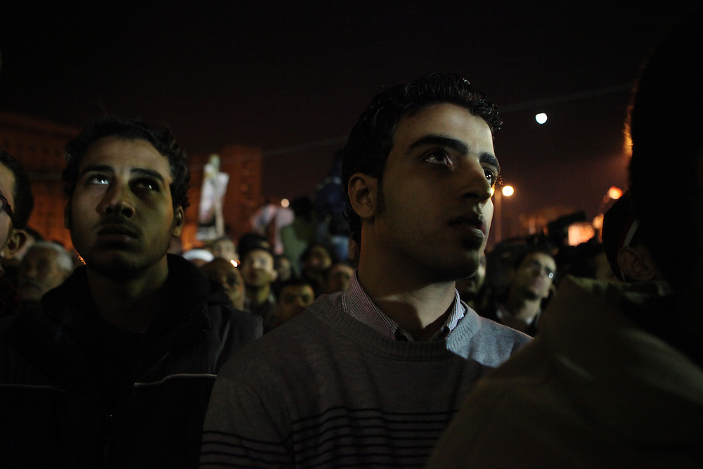 Pro-democracy protesters watch the third speech of Mubarak since protests began calling for his ouster.