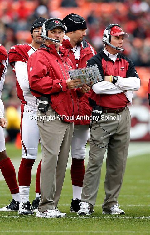 (L-R) Arizona Cardinals head coach Ken Whisenhunt and defensive coordinator Bill Davis look on during the NFL week 17 football game against the San Francisco 49ers on Sunday, January 2, 2011 in San Francisco, California. The 49ers won the game 38-7. (©Paul Anthony Spinelli)