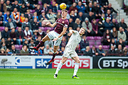 Jimmy Dunne (#3) of Heart of Midlothian wins a header during the Ladbrokes Scottish Premiership match between Heart of Midlothian and Aberdeen at Tynecastle Stadium, Edinburgh, Scotland on 20 October 2018.