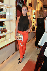 ROXIE NAFOUSI at the Roger Vivier 'The Perfect Pair' Frieze cocktail party celebrating Ambra Medda & 'Miss Viv' at the Roger Vivier Boutique, Sloane Street, London on 15th October 2014.