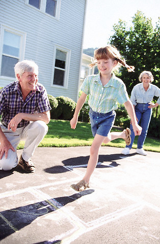 Hopscotch granddaughter --- Image by © Jim Cummins/CORBIS