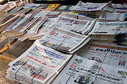 Egyptian newspapers printed in Arabic on sale at a street vendor in modern Luxor, Nile Valley, Egypt.