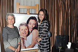 Left to right, YVONNE TAPPER and her daughter actress ZOE TAPPER and a photograph of them at The Great Initiative event in association with jewellers Boodles held at The Corinthia Hotel, London on 6th November 2012.