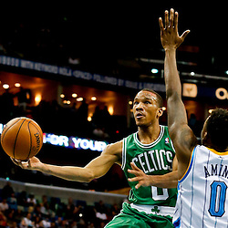 Mar 20, 2013; New Orleans, LA, USA; Boston Celtics point guard Avery Bradley (0) shoots over New Orleans Hornets small forward Al-Farouq Aminu (0) during the second half of a game at the New Orleans Arena. The Hornets defeated the Celtics 87-86. Mandatory Credit: Derick E. Hingle-USA TODAY Sports